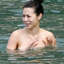 China Chow Goes Topless At The Beach Photos 15